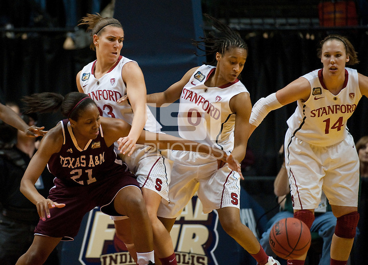 INDIANAPOLIS, IN - APRIL 3, 2011: Jeanette Pohlen, Melanie Murphy and Kayla Pedersen look for a loose ball during the NCAA Final Four against Texas A&M at Conseco Fieldhouse  in Indianapolis, IN on April 1, 2011.