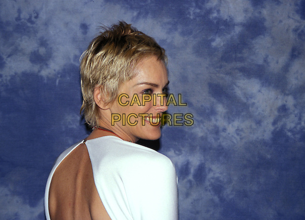 SHARON STONE.headshot, portrait, looking over shoulder.www.capitalpictures.com.sales@capitalpictures.com.© Capital Pictures.