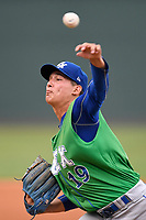 Starting pitcher Garrett Davila (19) of the Lexington Legends warms up before a game against the Greenville Drive on Friday, June 30, 2017, at Fluor Field at the West End in Greenville, South Carolina. Lexington won, 17-7. (Tom Priddy/Four Seam Images)