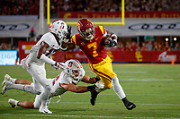 LOS ANGELES, CA - SEPTEMBER 8: USC Trojans running back Stephen Carr #7 runs toward the end zone under pursuit from Stanford Cardinal linebacker Casey Toohill #52 and cornerback Kyu Blu Kelly #17 during a game between USC and Stanford Football at Los Angeles Memorial Coliseum on September 7, 2019 in Los Angeles, California.
