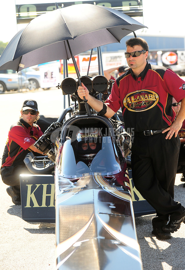 Sept. 23, 2011; Ennis, TX, USA: NHRA crew members for top fuel dragster driver Del Worsham during qualifying for the Fall Nationals at the Texas Motorplex. Mandatory Credit: Mark J. Rebilas-