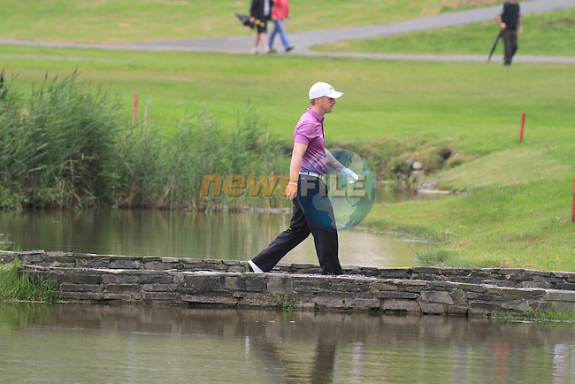 David Horsey walking over the bridge on the 18th to make a drop after his ball ended in the water during day two of the 3 Irish Open, at the Killarney Golf and Fishing Club, Killarney, Ireland.Picture Fran Caffrey/www.golffile.ie.