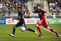 Lionard Pajoy (23) of the Philadelphia Union is marked by Arne Friedrich (23) of the Chicago Fire. The Chicago Fire defeated the Philadelphia Union 3-1 during a Major League Soccer (MLS) match at PPL Park in Chester, PA, on August 12, 2012.