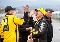 Feb 9, 2020; Pomona, CA, USA; NHRA pro stock driver Jeg Coughlin Jr celebrates with crew after winning the Winternationals at Auto Club Raceway at Pomona. Mandatory Credit: Mark J. Rebilas-USA TODAY Sports