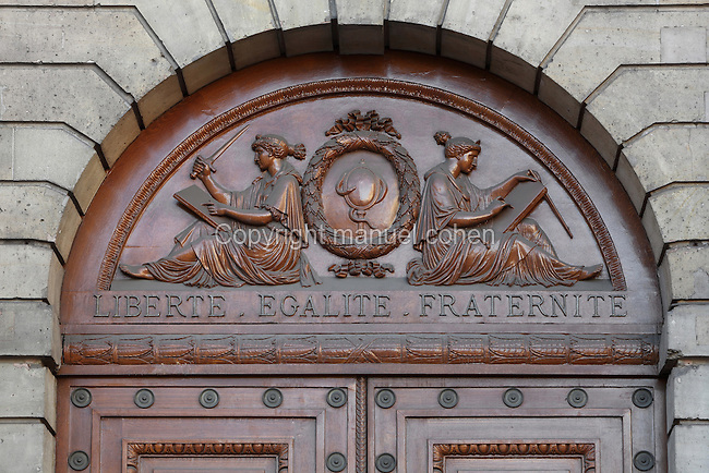 Detail of front door of The Senate, North facade, by Salomon de Brosse (1571-1626), Luxembourg Palace (Palais du Luxembourg), Paris, France. Above the door is the motto of the French Republic : Liberte, Egalite, Fraternite (Liberty, Equality, Fraternity). Photograph by Manuel Cohen.