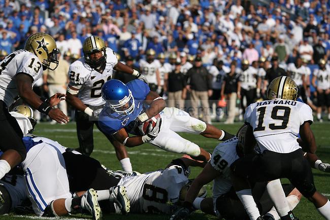 Tailback Derrick Locke dives into the endzone against Vanderbilt at Commonwealth Stadium on Saturday, Nov. 13, 2010. Photo by Scott Hannigan | Staff