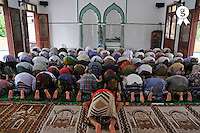 People praying inside a mosque (Licence this image exclusively with Getty: http://www.gettyimages.com/detail/83154243 )