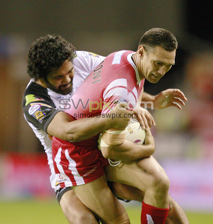 PICTURE BY CHRIS MANGNALL /SWPIX.COM...Rugby League - Super League  - Wigan Warriors v Bradford bulls - DW Stadium, Wigan, England  - 19/08/11... Wigan's  George Carmont tackled by  Bradford's Patrick Ah Van