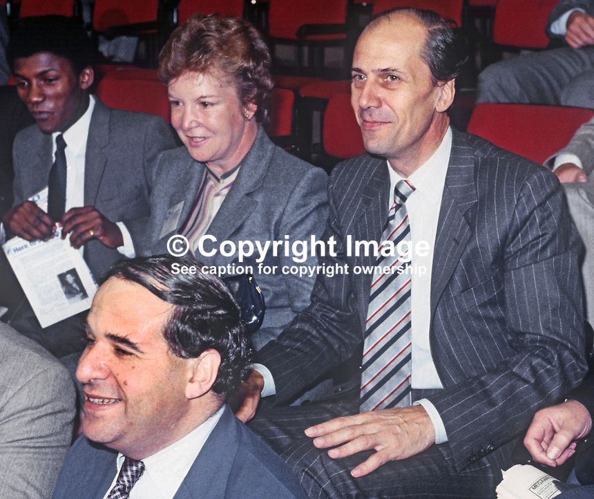 Secretary of State for Employment, Norman Tebbit, with his wife, Margaret Tebbit, in the audience at the annual conference, Conservative Party, held in Brighton, October 1982. It was two years later that Mr and Mrs Tebbit were to be seriously injured in the Provisional IRA bombing of the Grand Hotel adjacent to the Brighton Centre, the conference venue. Also in the photo is Leon Brittan, Chief Secretary to the Treasury. 198210142NT1.<br />