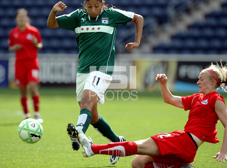 Washington Freedom defender Becky Sauerbrunn (22) slide tackles the ball away from Chicago Red Star forward Cristiane (11).  The Washington Freedom defeated the Chicago Red Stars 3-2 at Toyota Park in Bridgeview, IL on July 26, 2009.