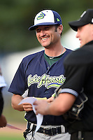 Vermont Lake Monsters manager David Newhan (11) during the lineup exchange before a game against the Jamestown Jammers on July 12, 2014 at Russell Diethrick Park in Jamestown, New York.  Jamestown defeated Vermont 3-2.  (Mike Janes/Four Seam Images)