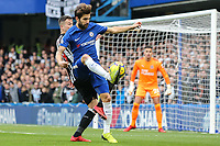 Cesc Fabregas of Chelsea holds up the ball during the Premier League match between Chelsea and Newcastle United at Stamford Bridge, London, England on 2 December 2017. Photo by David Horn.