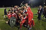 Walsall Wood FC 1 Atherstone Town 0, 02/05/2013. Oak Park, Midland Football Combination Premier Division. Walsall Wood players celebrating being presented with the league trophy after their match with Atherstone Town at Oak Park. The club were crowned champions of the Midland Football Combination premier division the previous night due to results elsewhere, their first league win in 61 years. Walsall Wood, who were formed in 1915, won the match 1-0 watched by 69 spectators. The club's main stand is unique to English football and only one of two in the UK, the other being at Arbroath FC in Scotland. Photo by Colin McPherson.