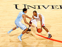 Virginia forward Akil Mitchell (25) handles the ball next to North Carolina forward James Michael McAdoo (43) during the game at the John Paul Jones arena in Charlottesville, Va. Photo/Andrew Shurtleff