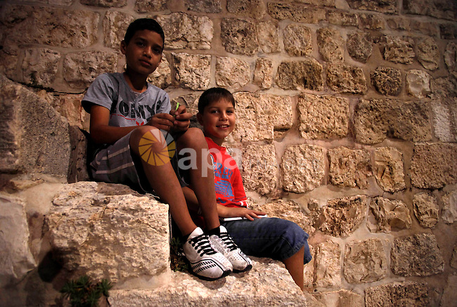 Palestinians children participate in a festival for during the fasting month of Ramadan in the city of Jerusalem, on July 29, 2013. Photo by Saeed Qaq