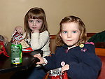Caitlin and Aoibheann Mullen at the O'Raghallaigh's Christmas party. Photo:Colin Bell/pressphotos.ie