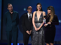 SANTA MONICA, CA - JANUARY 11: Gal Gadot (L) and director Patty Jenkins accept Best Action Movie for 'Wonder Woman' at the 23rd Annual Critics' Choice Movie Awards at Barker Hangar on January 11, 2018 in Santa Monica, California. (Photo by Frank Micelotta/PictureGroup)