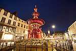 Dusk in Dumfries town centre Fountain in Queensberry Square looking up to Mid Steeple at night Scotland UK