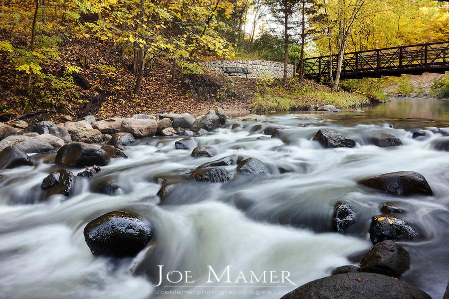 Nine Mile Creek in Bloomington, Minnesota, early autumn.