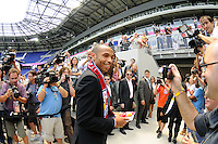 Thierry Henry exits the field after a photo opportunity prior to a New York Red Bulls press conference at Red Bull Arena in Harrison, NJ, on July 15, 2010.