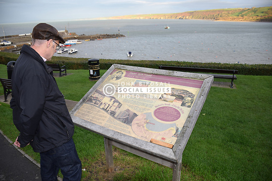 New Quay, Ceredigion, Wales. Tourist information board - Dylan Thomas wrote Under Milkwood here