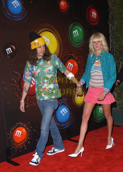 KIMBERLY STEWART & DATE.Experience the Color of M&M's at M&M's Brand City held on the corner of Hollywood and Argyle in Hollywood, California .11 March 2004.*UK Sales Only*.ull length, full-length, pink miniskirt, turquoise jacket.www.capitalpictures.com.sales@capitalpictures.com.©Capital Pictures.