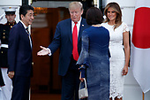 US President Donald J. Trump (2-L) and First Lady Melania Trump (R) greet Japanese Prime Minister Shinzo Abe (L) and First Lady Akie Abe (2-R) at the South Portico of the White House in Washington, DC, USA, 26 April 2019. President Trump is hosting a dinner for Prime Minister Abe and his wife celebrating First Lady Melania Trump's 49th birthday.<br /> Credit: Shawn Thew / Pool via CNP