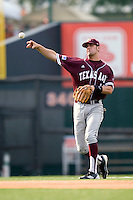 Texas A&M Aggies shortstop Kenny Jackson #15 throws to first base against the Texas Longhorns in NCAA Big XII Conference baseball on May 21, 2011 at Disch Falk Field in Austin, Texas. (Photo by Andrew Woolley / Four Seam Images)