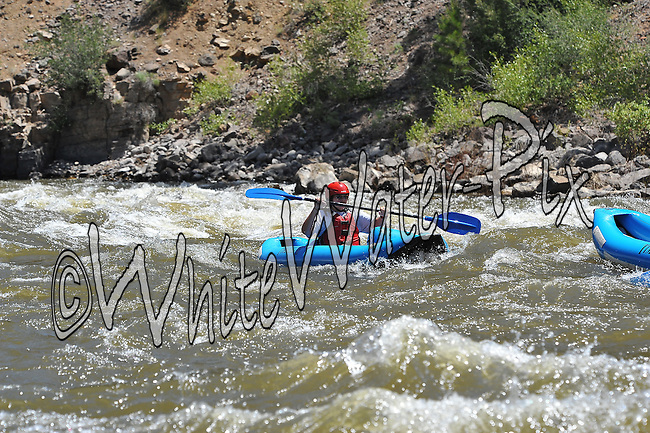 Nova Guides crashing Cable Rapid while floating the Upper Colorado River from Rancho Del Rio to State Bridge on the morning of June 25, 2014.