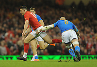 Wales Owen Watkins gets away from Italy&rsquo;s Sergio Parisse<br /> <br /> Photographer Ian Cook/CameraSport<br /> <br /> 2018 NatWest Six Nations Championship - Wales v Italy - Sunday 11th March 2018 - Principality Stadium - Cardiff<br /> <br /> World Copyright &copy; 2018 CameraSport. All rights reserved. 43 Linden Ave. Countesthorpe. Leicester. England. LE8 5PG - Tel: +44 (0) 116 277 4147 - admin@camerasport.com - www.camerasport.com
