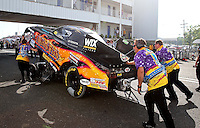 May 31, 2013; Englishtown, NJ, USA: NHRA crew members for funny car driver Tony Pedregon push the car under the bridge during qualifying for the Summer Nationals at Raceway Park. Mandatory Credit: Mark J. Rebilas-