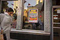 A sign in the window of a McDonald's restaurant in New York on Wednesday, January 2, 2013 directs prospective employees to franchise locations where they can apply for work. (© Richard B. Levine)