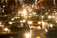 THIS IMAGE IS AVAILABLE EXCLUSIVELY FROM CORBIS.....PLEASE SEARCH FOR IMAGE # 42-20075365 ON WWW.CORBIS.COM....Traffic on 8th Avenue at Night, Midtown Manhattan, New York City, New York State, USA