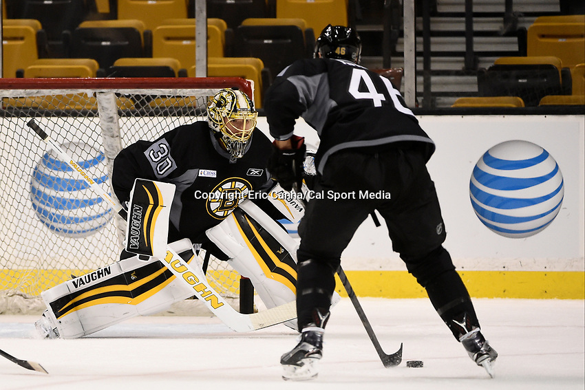 September 18, 2015 - Boston, Massachusetts, U.S. - Boston Bruins goalie Jeremy Smith (30) tries to defend the net from center David Krejci (46) during the Boston Bruins training camp held at TD Garden in Boston Massachusetts. Eric Canha/CSM
