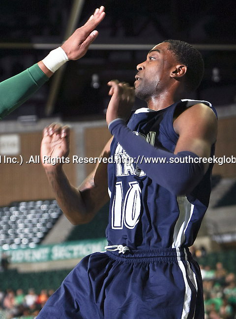 Jackson State Tigers guard Tyrone Hanson (10) gets a hand in his face during the game between the Jackson State Tigers and the University of North Texas Mean Green at the North Texas Coliseum,the Super Pit, in Denton, Texas. UNT defeated Jackson 68 to 49