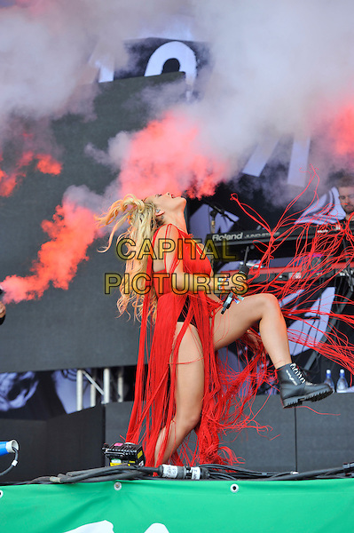 Rita Ora <br /> performing at Glastonbury Festival, Worthy Farm, Pilton, Somerset, <br /> England, UK, 28th June 2013.<br /> live on stage music gig full red tassels dress hotpants microphone black pants side leg kicking fringed<br /> CAP/MAR<br /> &copy; Martin Harris/Capital Pictures