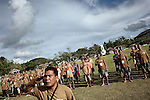 Every day at 5:30 all the minimun security inmates has to ghater under the philippino flag at the center of Iwahig Prison central, Jan 2012..Iwahig Prison and Penal Farm is essentially a village in complete contrast of a penal establishment one would have in mind. There are about a two thousand prisoners there and in the center of all their work is the central village square.