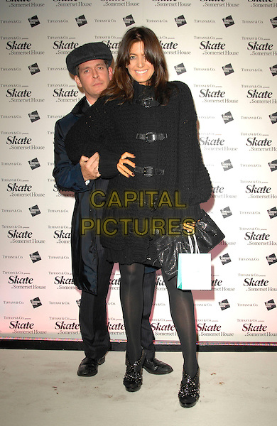 TOM HOLLANDER & CLAUDIA WINKLEMAN.At Somerset House Ice Rink VIP Launch Party, London, England, November 20th 2007. .full length black coat jacket hat cap.CAP/CAN.©Can Nguyen/Capital Pictures