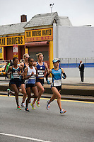 Yuri Kano leads a second pack of Women's Elite runners as they approach Mile 7 in the ING New York City Marathon.