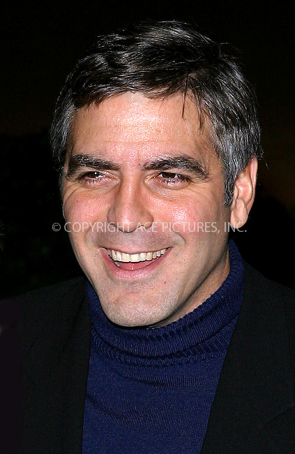 George Clooney at the NY premiere of 'Confessions Of A Dangerous Mind' held at the Paris Theater. New York, December 19, 2002..Please byline: NY Photo Press. REF: M19 -- THIS REFERENCE CODE MUST APPEAR ON YOUR SALES REPORT, THANK YOU.....*PAY-PER-USE*      ....NY Photo Press:  ..phone (646) 267-6913;   ..e-mail: info@nyphotopress.com