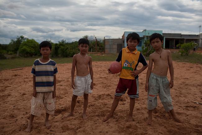 Vietnamese children play soccer on the bluffs overlooking Mui Ne beach.