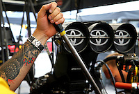 Oct 6, 2013; Mohnton, PA, USA; Detailed view of a crew member for NHRA top fuel dragster driver Morgan Lucas in the pits during the Auto Plus Nationals at Maple Grove Raceway. Mandatory Credit: Mark J. Rebilas-