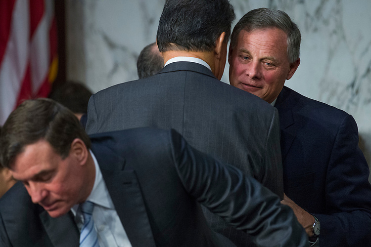 "UNITED STATES - MAY 11: Chairman Richard Burr, R-N.C., right, talks with Sen. Joe Manchin, D-W.Va., before a Senate (Select) Intelligence Committee hearing in Hart Building titled ""World Wide Threats"" on May 11, 2017. (Photo By Tom Williams/CQ Roll Call)"