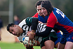 Aukustino Tapu gets plenty of attention fron Carwyn Chase & Amos Mataia. Counties Manukau Premier Club Rugby game between Ardmore Marist and Manurewa, played at Bruce Pulman Park, Papakura on Saturday July 18th 2009..Ardmore Marist won the game 32 - 5 after leading 10 - 5 at halftime.