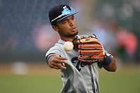 Right fielder Daniel Montano (24) of the Asheville Tourists warms up before a game against the Greenville Drive on Friday, August 23, 2019, at Fluor Field at the West End in Greenville, South Carolina. Greenville won, 11-1. (Tom Priddy/Four Seam Images)