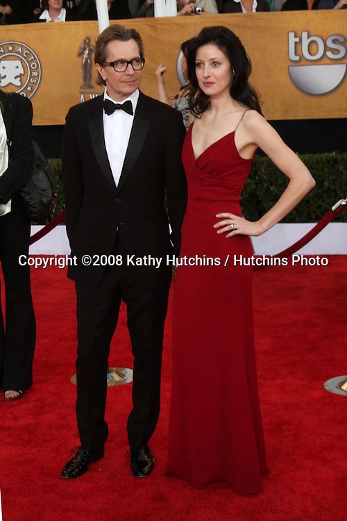 Gary Oldman & Wife. arriving at the Screen Actors Guild Awards, at the Shrine Auditorium in Los Angeles, CA on .January 25, 2009.©2008 Kathy Hutchins / Hutchins Photo..