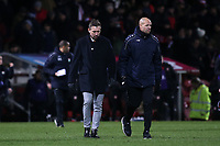 Barnet Manager, Darren Currie walks towards the dressing room at half-time with his Assistant, Junior Lewis during Brentford vs Barnet, Emirates FA Cup Football at Griffin Park on 5th February 2019