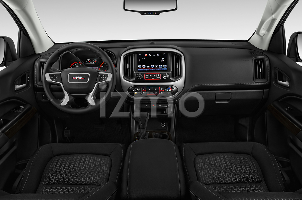 Stock photo of straight dashboard view of a 2019 GMC Canyon 4WD SLE Extended Cab 5 Door Pick Up