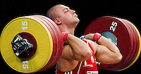 11 DEC 2011 - LONDON, GBR - Bartlomiej Bonk (POL) lifts during the men's +105kg category Clean and Jerk of the London International Weightlifting Invitational and 2012 Olympic Games test event held at the ExCel Exhibition Centre in London, Great Britain .(PHOTO (C) NIGEL FARROW)