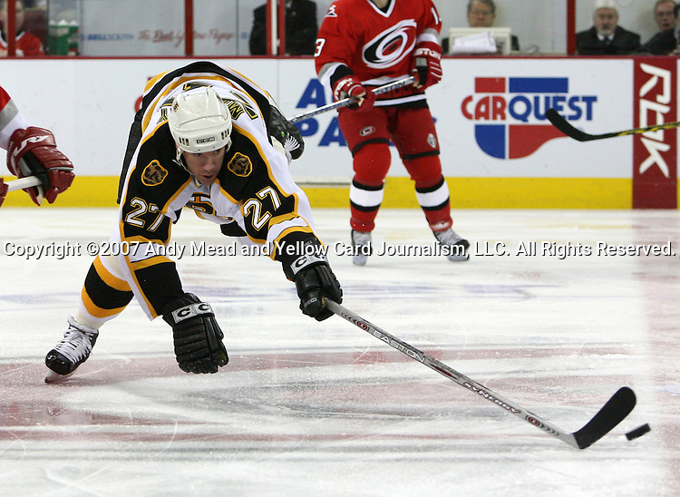 Boston's Glen Murray dives after the puck on Saturday, February 3, 2007 at the RBC Center in Raleigh, North Carolina. The Boston Bruins defeated the Carolina Hurricanes 4-3 after overtime in a regular season National Hockey League game.